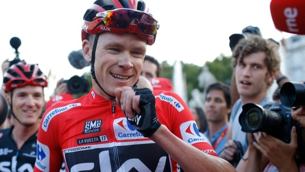 Britain's Chris Froome rejoices after winning the Spanish Vuelta cycling race.