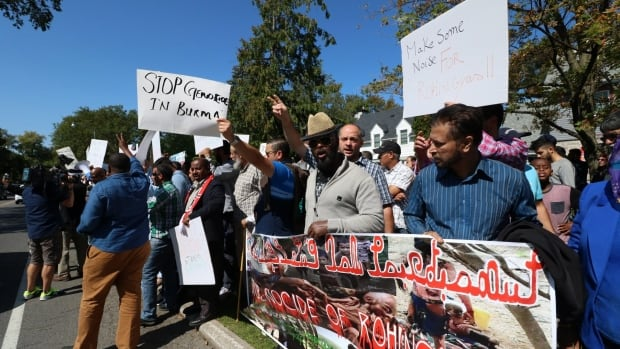 Hundreds of protesters gathered outside the Myanmar Embassy in Ottawa on Sept. 10, 2017, demanding an end to escalating violence against the country's Rohingya minority.