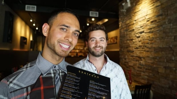 "Fouzon Beg (left) is the owner of Thaifoon restaurant, which is seeing menu changes. Mark Henshaw (right) is a server at the restaurant who brought up the issue of using the word ""suicide"" to describe a menu option."