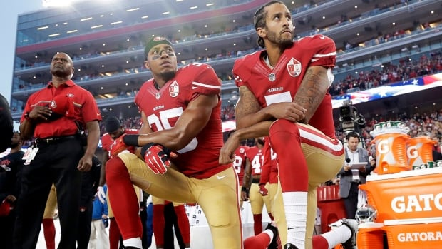 In this Monday, Sept. 12, 2016, file photo, San Francisco 49ers safety Eric Reid (35) and former quarterback Colin Kaepernick (7) kneel during the national anthem. Reid continued the protest on Sunday without Kaepernick.