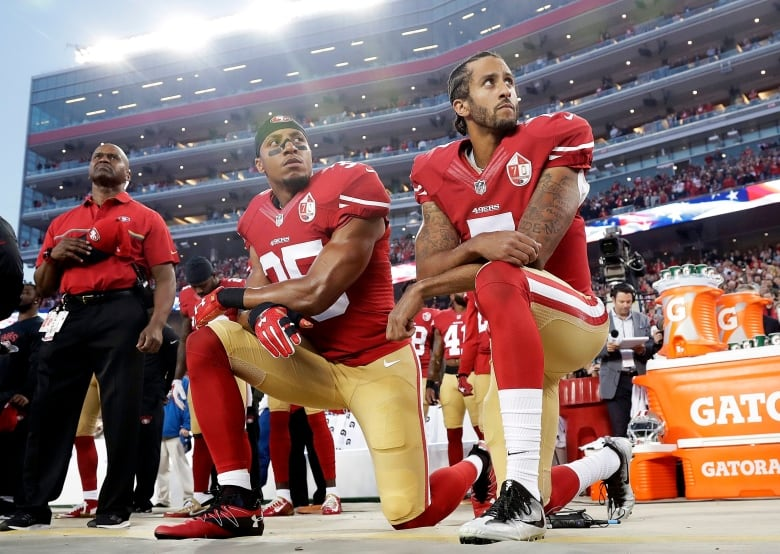 9ed5a01d In this 2016 file photo, San Francisco 49ers safety Eric Reid (35) and  former quarterback Colin Kaepernick (7) kneel during the U.S. national  anthem.