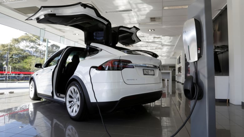 A Model X Vehicle Charges At A Tesla Electric Car Dealership In Sydney,  Australia. Tesla Says It Temporarily Boosted The Battery Capacity For Some  Model S ...