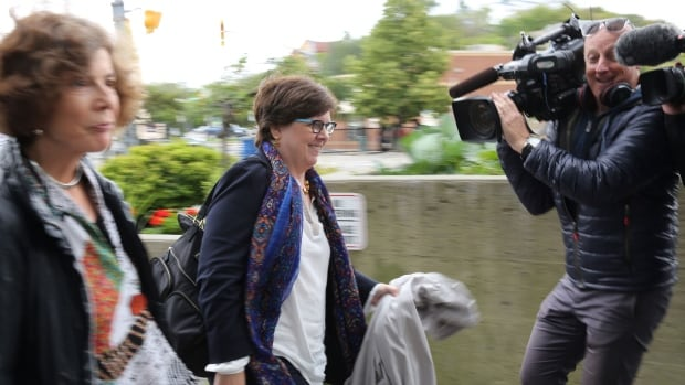 Former Liberal Party CEO Pat Sorbara passes the media on her way to court in Sudbury to stand trial on bribery charges.