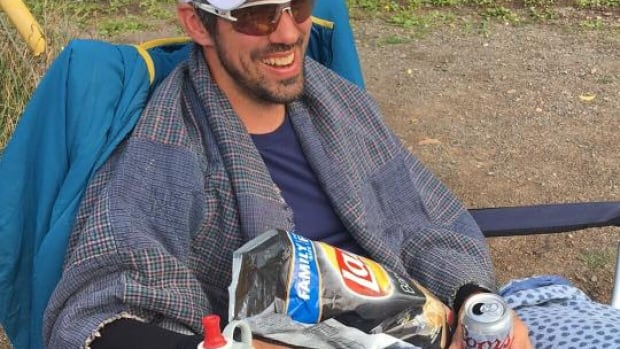 Tim Barry celebrates at the finish line in Riverview with a true breakfast of champions.