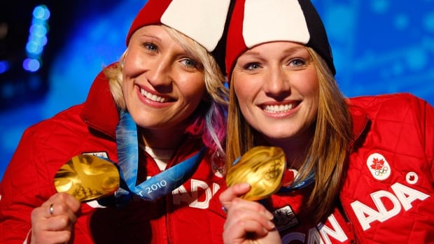 Canadian brakeman Heather Moyse, right, and driver Kaillie Humphries, left, have won gold medals at the last two Olympics.