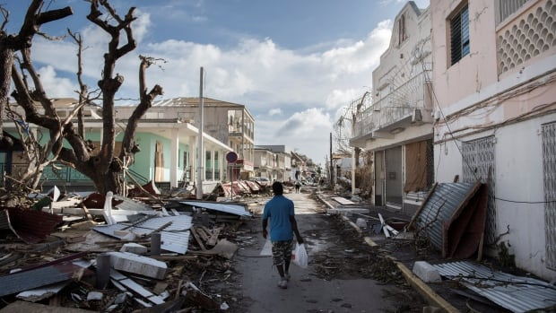 A man walks on a street covered in debris after Hurricane Irma passed over St. Maarten on Sept. 8, 2017.