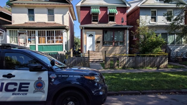 A Thunder Bay police vehicle is parked outside of a home (centre) in the 200 block of Syndicate Avenue where a sudden death took place on Sunday, Sept. 10. The home remained cordoned off by police tape on Monday afternoon.