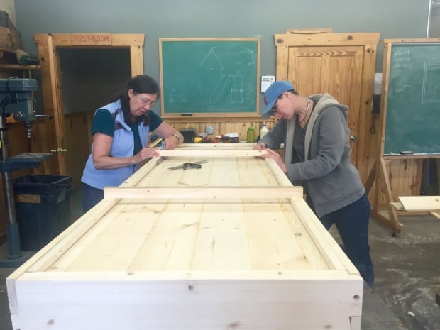 Libby and Sarah Hoops, working on their casket