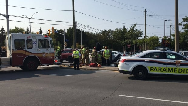 Two people had to be extricated from their car after it rolled Monday afternoon at the intersection of Woodroffe Avenue and Baseline Road.