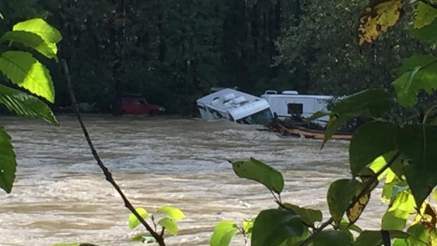 Several motorhomes and other vehicles are engulfed by the Kitimat River, which rose quickly overnight after 36 hours of heavy rains.
