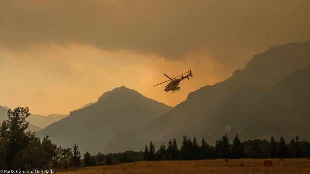 A helicopter takes flight during firefighting efforts in Waterton Lakes National Park.
