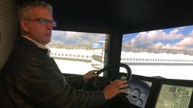 Lee Malanchuk from the Yukon government's Transport Services branch was one of the people who took a spin on the school bus driving simulator on Monday.