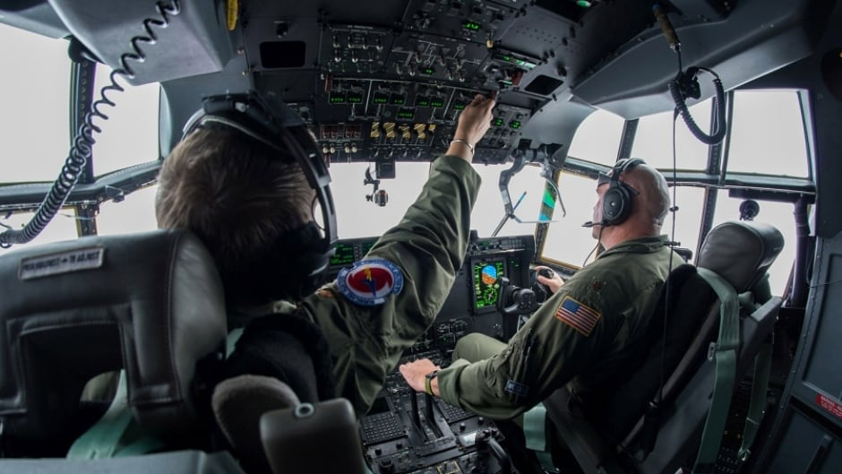 Air Force Reserve pilots Maj. Byron Hudgins, left, and Maj. Kendall Dunn, of the 53rd Weather Reconnaissance Squadron Hurricane Hunters, fly their WC-130J Super Hercules through Hurricane Irma, south of Florida, Sept. 10, 2017.