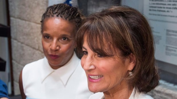 Quebec Immigration, Diversity and Inclusiveness Minister Kathleen Weil, right, announced the inquiry last July alongside Tamara Thermitus, president of the Quebec Human Rights Commission.