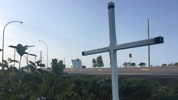 A metal cross at the intersection of Routes 10 and 1-A in central Bedeque, P.E.I. The site is where a crash killed Dorothy Mae Mayhew, 67, in 2015.