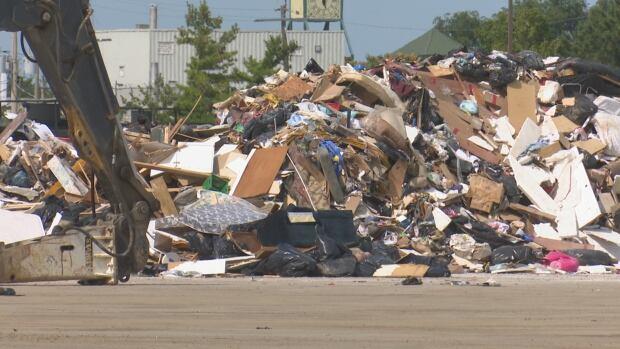 Flood debris piles up at the former GM Transmission Plant on Sept. 11, 2017.