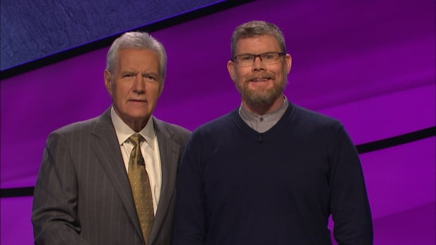 Christopher Fennell and Jeopardy! host (and alum of the University of Ottawa, where Fennell teaches) Alex Trebek.