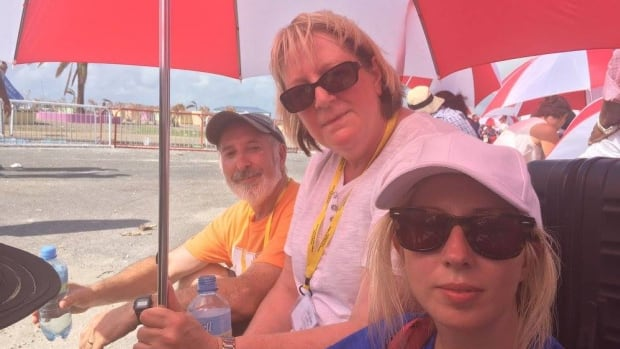Parents Gord and Pauline Parrill with daughter Allison, waiting for help at the airport in Sint Maarten.