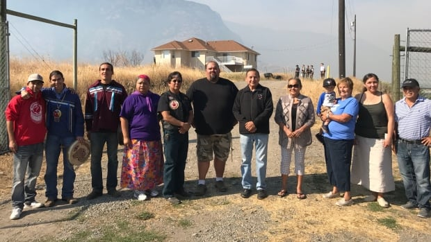 Members of the Lower Similkameen Indian Band pose for a photo after being granted access to a private property in Cawston, B.C.