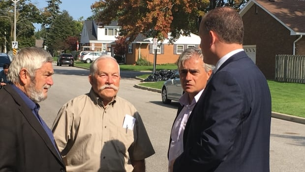 Ontario Minister of Municipal Affairs Bill Mauro talks to Windsor-Essex mayors on a tour of flood-damaged areas.