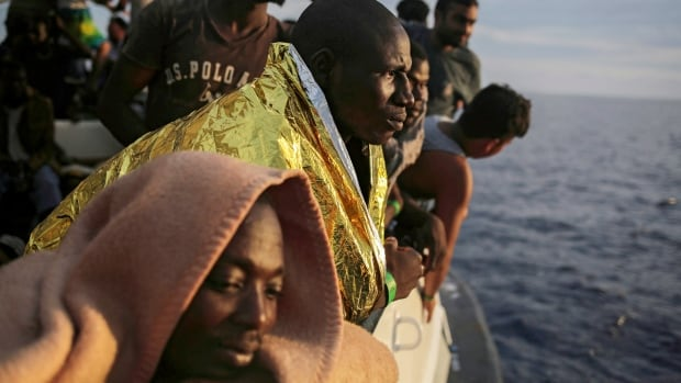 Migrants are shown Sept. 7 as they wait to reach the Italian coast on the Mediterranean Sea a day after being rescued off the Libyan coast. While the number of Europe-bound migrants rescued on the main Mediterranean Sea route has dropped off dramatically in 2017, it is still the predominant path due to the closing of routes and anti-immigration sentiment in eastern Europe.