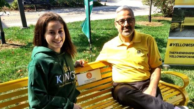 Sam Fiorella (right) sits on the newly installed friendship bench with his daughter Vanessa.
