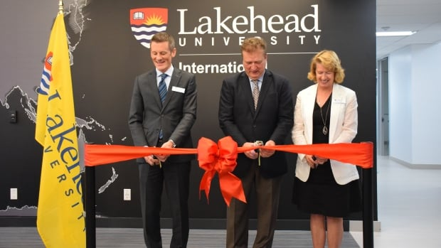 (L-R) Lakehead University vice-provost James Aldridge, president Brian Stevenson, and vice-president of academics Moira McPherson cut the ribbon at Lakehead University's official opening of its International Centre on Tuesday, Sept. 12.