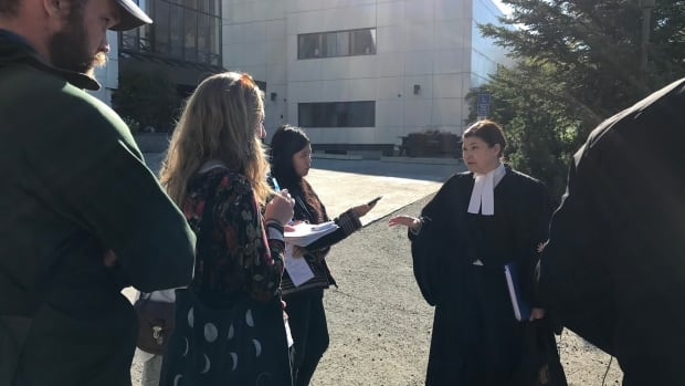 Anik Morrow, who has served as Michael Nehass's defence lawyer, addressed reporters outside of the Yukon courthouse Tuesday. She supports the call for a public inquiry into Nehass's ordeal. 'It is inexplicable that [arrangements to transfer to a hospital] were not made earlier,' she said.