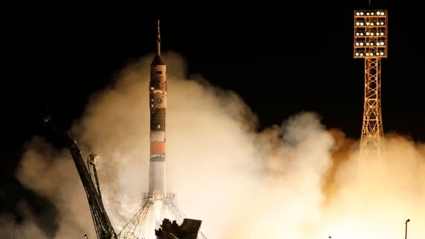 The Soyuz spacecraft carrying a new crew to the International Space Station blasted off in Kazakhstan Tuesday.