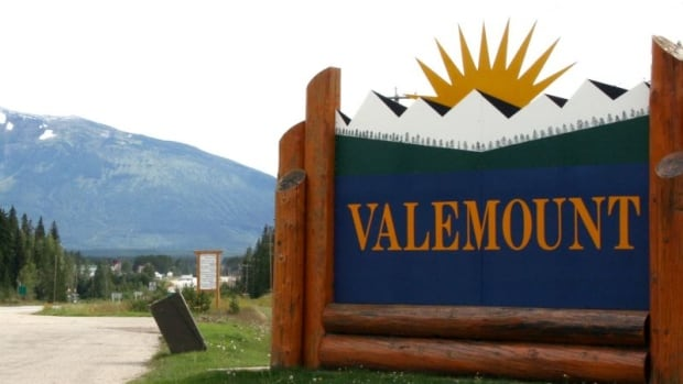 "A roadside mechanic would like to see a bathroom added near this ""Welcome to Valemount"" sign because of the amount of human waste left at the stop."
