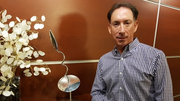 Dr. Errol Billinkoff keeps the washroom key on a sabre and a sperm-like sculpture near the front door at the Winnipeg office where he performs thousands of vasectomies.