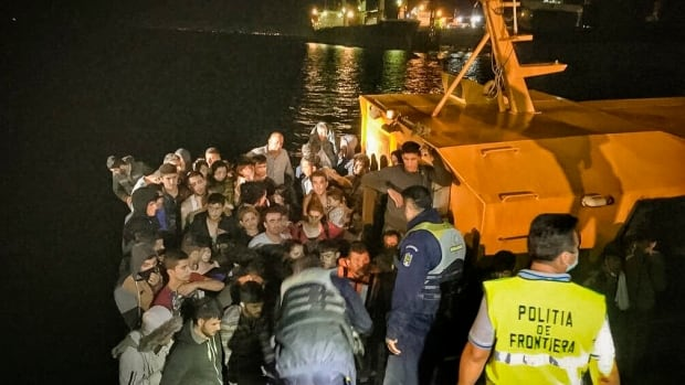 Romania's Coast Guard has rescue 157 migrants from Iraq and Iran, including 56 children, from a ship in distress on the Black Sea, on what is becoming a new route for migrants trying to reach Western Europe.