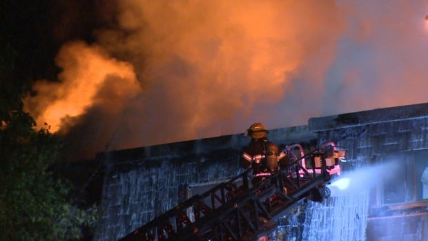 Flames started tearing through the roof early Wednesday morning, after hours of firefighting efforts.