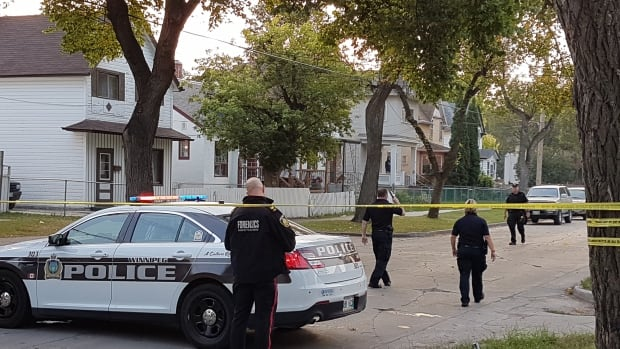 Forensic investigators are on Alfred Avenue on Wednesday morning after a police-involved shooting death.