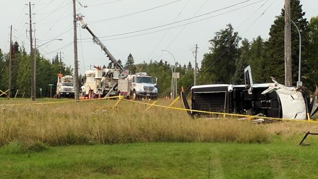 A heavily-damaged white pickup truck lies on its side just east of Balmoral Street in Thunder Bay on Wednesday, Sept. 13. Police had closed Balmoral from just north of Lithium Drive to Beverly Street as they investigated.