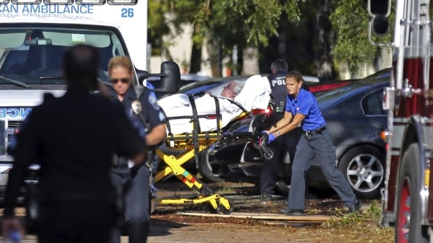A woman is transported from The Rehabilitation Center at Hollywood Hills as patients are evacuated after a loss of air conditioning due to Hurricane Irma on Wednesday in Hollywood, Fla.  Several  patients at the sweltering nursing home died in Hurricane Irma's aftermath, authorities said Wednesday.