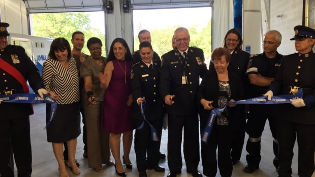 Members of Toronto Paramedic Services and community representatives cut the ribbon at the new paramedic hub - now the city's largest.
