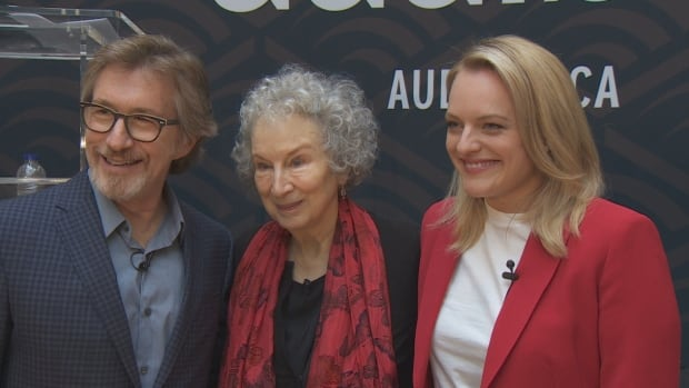 Audible CEO Don Katz, left, is joined by author Margaret Atwood and actor Elisabeth Moss for a reading of The Handmaid's Tale, to mark the launch of the audiobook retailer's Canadian website.