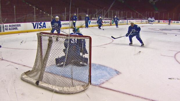 Canucks goaltender Anders Nilsson takes shots in a drill at training camp.
