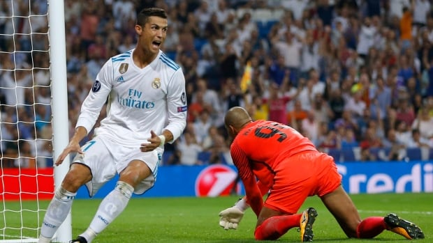 Real Madrid's Cristiano Ronaldo reacts after scoring on APOEL goalkeeper Boy Waterman during a Champions League match on Wednesday.
