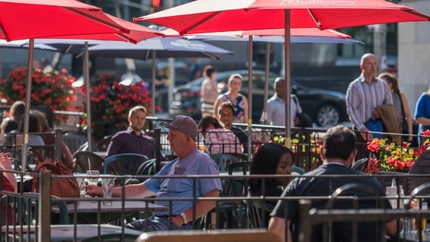 Patrons of a Sparks Street patio enjoy balmy late summer weather in Ottawa on Sept. 13, 2017. The mild temperatures continue today with a daytime high of 27 C.