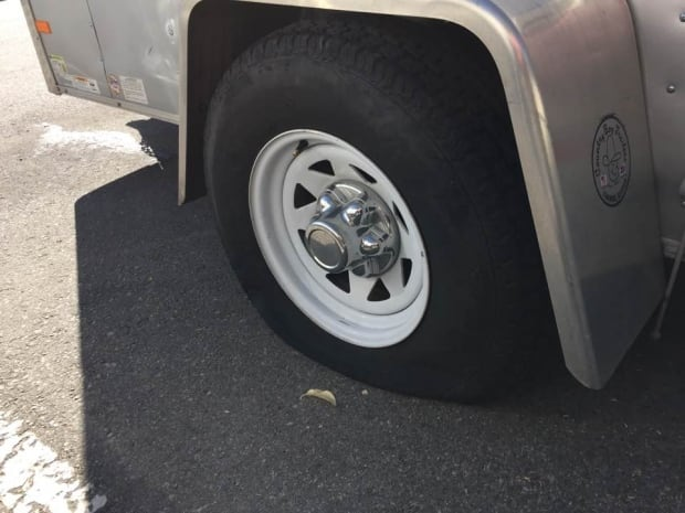 Monk Trailer Tire Slashed