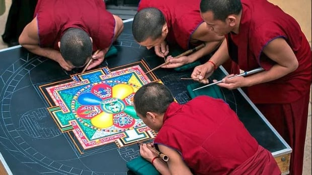 A group of touring monks will be building a sand mandala at the Penticton Art Gallery until Sunday.