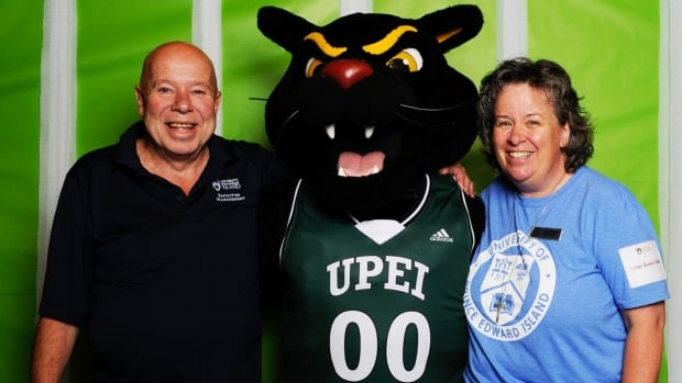 Rocky Paquet poses with Sister Sue Kidd and the UPEI mascot.