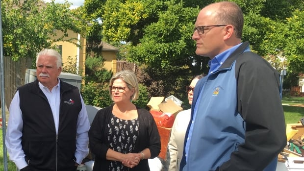 Ontario NDP leader Andrea Horwath (centre) toured flood damage in hard-hit areas  along with MPP Percy Hatfield (left) and Windsor Mayor Drew Dilkens, shortly after flooding damaged some 6,000 Windsor homes.