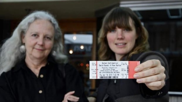 Activist Alexandra Morton and Twyla Roscovich pose with a ticket stub from the independent filmmaker's work, Salmon Confidential.