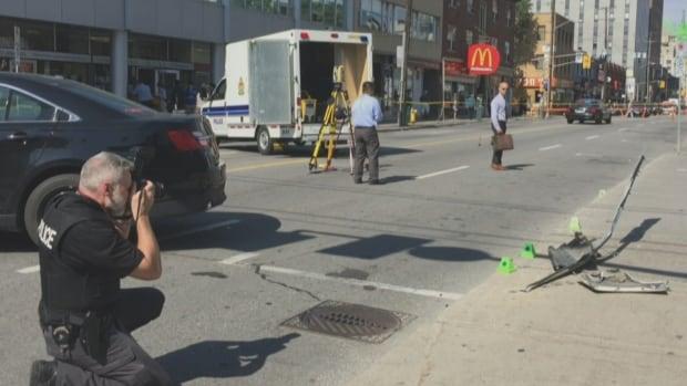 Ottawa paramedics respond to a pedestrian struck by a cab on an Elgin Street sidewalk Thursday morning.