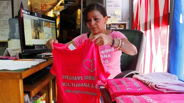 In Tijuana Mexico Sept. 5 Yolanda Varona who was deported in 2010 and separated from her two children in the United States organizes shirts of the Dreamer's Moms a group founded in the United States by parents of Dreamers and other activists