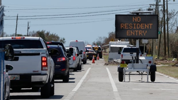 Motorists line up to enter the Keys at a checkpoint in the aftermath of Hurricane Irma on Thursday in Florida City. But some residents of the Florida Key were turned away as authorities considered the conditions still too dangerous, due to a lack of electricity, clean water and 911 service.