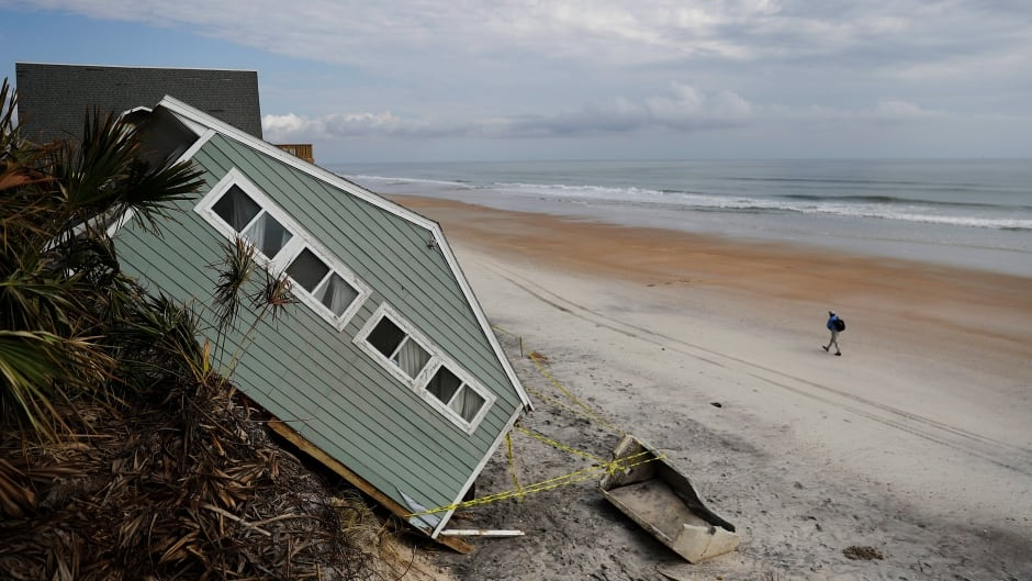 A house rests on the beach after collapsing off a cliff from Hurricane Irma in Vilano Beach, Fla., Friday, Sept. 15, 2017.